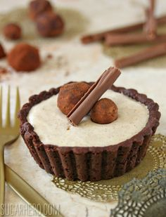"Cinnamon Mousse Tarts with a Mexican Chocolate Crust. Topped with a chocolate ""cinnamon stick!"" 