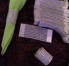 Rolls of diamond mesh material cut into small strips and with velcro attached make GREAT napkin rings. I'm sure your party guests will be running around collecting a set of 8 to 12 to take home for their own table.