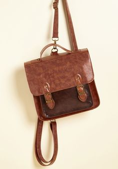 Have a Pack-Up Plan Convertible Bag | Mod Retro Vintage Bags | ModCloth.com Carrying this faux-leather bag is both Plan A and B for the day! With options to carry this structured satchel by its top handle or removable backpack straps, you choose the decorative buckles, dark front pocket, and retro sensibilities of this brown bag every time.