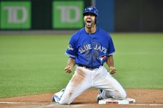 Toronto Blue Jays pinch-runner Dalton Pompey reacts as he's safe at third base during seventh inning game 5 American League Division Series baseball action in Toronto on Wednesday, Oct. 14, 2015. (Nathan Denette / THE CANADIAN PRESS)