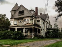 Front view of the Horace L. Hine house in the Village of Mantua Ohio. Despite the deterioration and overgrowth, it is still a grand old house. It is listed on the National Register of Historic Places.