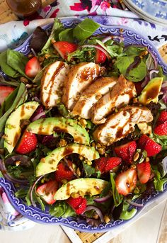 Ready in minutes, this Strawberry Avocado Salad is paired with a Brown Sugar Balsamic Chicken recipe and then sprinkled with crunch pistachios! | @suburbansoapbox