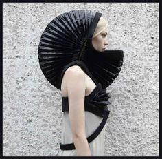 Ukrainian designer Irina Dzhus is certainly thinking outside the fashion box with her DZHUS concept collection, presenting pieces of clothing as 'metaphysical objects.' For all their striking weirdness, many of these garments appear to be quite practical, transforming or offering hidden storage. It's not hard to imagine the accordion-like headgear being incorporated into a functional rain suit of some sort.