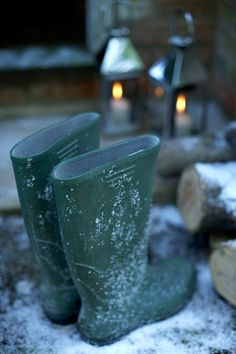 This reminds me so much of my late husband.  The green wellies, fresh cut logs, snow, and lanterns bring back memories of our little cabin in the Berkshires, Connecticut.