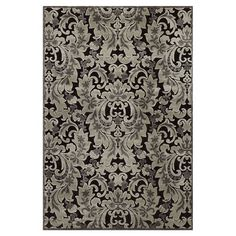 Perfect as an artful finishing touch to your living room or master suite decor, this loomed art silk rug showcases a damask-inspired leaf motif.