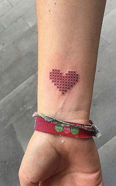 Cross-stitch heart tattoo.