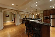 Image result for wood and stone column in basement bar