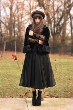 Chiffon midi skirt, black fur lined coat, lace long sleeved top, fur hat