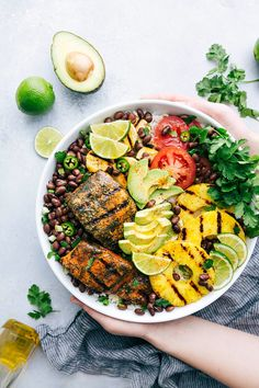 Cuban-inspired, healthy, and nutritious Mojo Salmon Bowls made with salmon, black beans, grilled pineapple, and avocado. A delicious and healthy meal everyone will love!