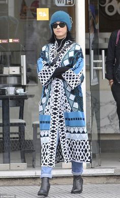 Out in the cold: Katy Perry kept her best assets underwraps as she hit the shops during a leisurely day out in Buenos Aires on Monday