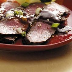 Contest-Winning Grilled Asian Flank Steak Recipe -This recipe is a tender, lighter variation of the marinated ginger-sake flank steak my mother used to make. It has a wonderful flavor and aroma. Asian Flank Steak, Beef Flank Steak, Flank Steak Recipes, Easy Steak Recipes, Grilled Steak Recipes, Fun Easy Recipes, Grilled Meat, Grilling Recipes, Meat Recipes