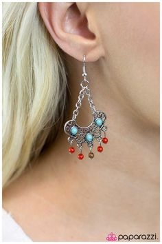 Jane of The Jungle - Multi ~ Dainty red and brown beads dangle from the bottom of a silver pendant decorated in swirling filigree and blue stones. Suspended by two silver chains, the airy pendant hangs in a chandelier design.