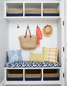 Pretty entryway / mudroom design - love the bench with hooks and the matching baskets dipped in navy are great for organizing hats and umbrellas
