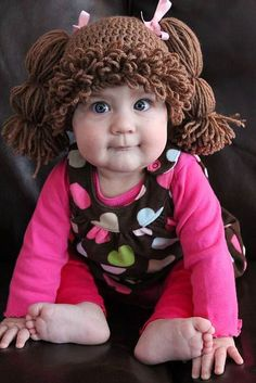 Cabbage Patch Kids Inspired Hat-  I'm going nuts over these hats!!!!!  This is just too cute.  Who has a baby so I can get one of these for them?!