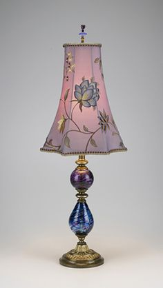 Roxy Lamp. Violet and blue colored blown glass pieces; star shaped covered in violet/blue embroidered silk taffeta; beaded finial.