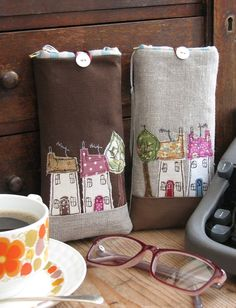 In A Row - appliquéd houses sewn glasses case