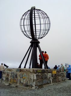 """North Cape, Norway   North Cape is a cape on the island of Magerøya in northern Norway. Its 307 m high cliff is often referred to as """"the northernmost point of Europe"""", located at 71°10′21″N."""