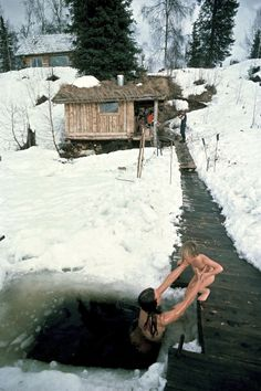 The forest people in Alaska United States The Johnston family swimming in the frozen lake after the sauna