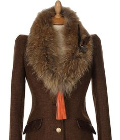 The stunning Raccoon fur collar featuring the hand made leather tassel in orange available online now from £99 http://www.hollandcooper.com/raccon-fur-collar-mayfair-leather-tassels.html