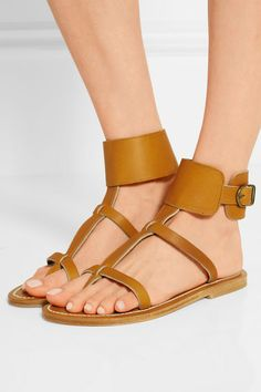 Each pair of K Jacques St Tropez's sandals are handmade by artisans in France. A timeless addition to your summer wardrobe, this 'Caravelle' style is made from tan leather and secured at the ankle with a wide band and a single buckle. Wear yours with everything from dresses to denim.