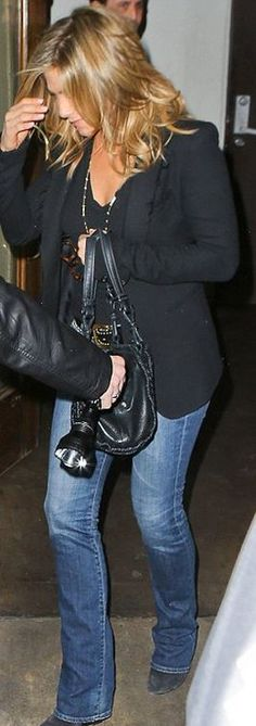 jennifer aniston  Who made  Jennifer Anistons blue flared jeans and black woven leather handbag?