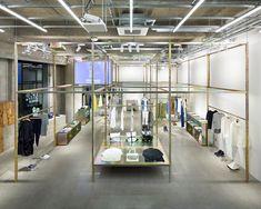 schemata architects installs iridescent frame to highlight cabane de zucca store in tokyo
