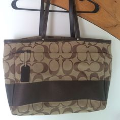 Large coach bag 14 inches x 12 inches, signature canvas materiel in classic brown, leather handles and leather coach tag Coach Bags