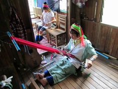 This long-necked Padaung woman is using a back-strap loom at a workshop near Inle Lake, Myanmar (Burma). Originally the brass neck rings were said to protect the woman against slavery by making them less attractive to other tribes. Neck Rings, Inle Lake, Back Strap, Loom, Workshop, Brass, Woman, Atelier, Loom Weaving