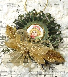 Easy edged punched rosette Christmas ornament or Would be cute on a card or as a package topper.