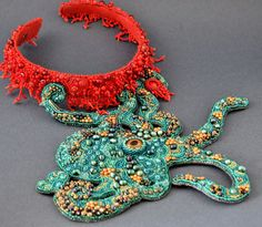 Octopus Bead Embroidery Necklace by Crimson Frog on Etsy.  I couldn't wear something like this, but it's interesting to see how she's managed to create a bead-embroidered piece with such a complex shape.