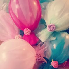 Tulle covered balloons with roses, magenta, pink, lilac, emerald and lime green for my daughter Maya's first birthday - created by Leah Bischoff