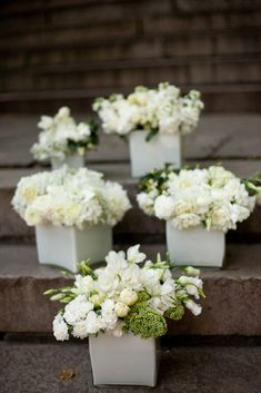 boxes of flowers instead of vases - love the white with white and a little green!