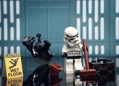Stormtrooper mopping wet floor and Darth Vader slipping