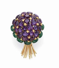 AN AMETHYST, EMERALD AND COLORED DIAMOND BROOCH, BY VERDURA Designed as an oval-cut amethyst bouquet with circular-cut yellow diamond accents, to the cabochon emerald leaves and polished gold stems, mounted in 18k gold Signed Verdura