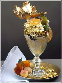 """Golden Opulence Sundae most expensive food- This Sundae includes a edible gold leaf, rare chocolates and ice cream, served in a crystal goblet with an gold spoon. It also holds the Guinness World Record for """"Most Expensive Sundae. Most Expensive Ice Cream, Most Expensive Food, Expensive Cars, Chocolate Truffles, Chocolate Syrup, Haute Chocolate, Frozen Chocolate, Chocolate Covered, Gourmet"""