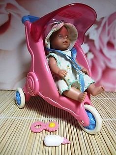 Mini baby born doll, Zapf creations, with a little pink stroller, lovely dress