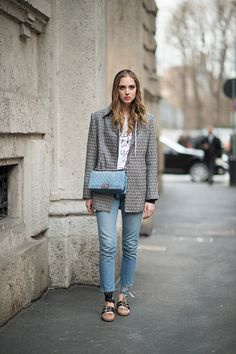 Chiara Ferragni is wearing a jacket from Fendi a piercing from Givenchy a bag from Chanel and Miu Miu shoes and jeans from Levis seen in the streets...