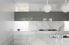 Marble kitchen inside the Garden House by Australian architect Allan Powell.