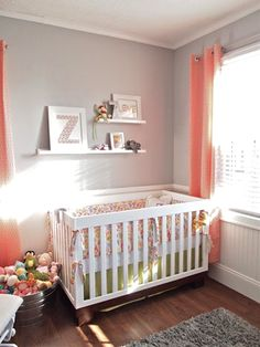 Love the idea of grey walls in a nursery so you can add pops of color with changing genders