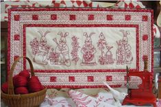 Bunny Bunch Table Runner -  A gang of cute RedWork Bunnies with twitching noses, whiskers and big floppy ears. Embroider them for Easter and Spring decorating showing off as a whimsical wall hanging, table runner or fun long pillow.
