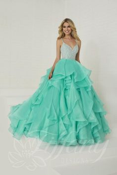Style 16300 from Tiffany Designs is a sleeveless, V-neck crystal organza ball gown with beaded spaghetti straps, a fully embellished sparkle and pearl bodice with criss cross back straps and a tiered ruffle organza skirt. Ball Gown Dresses, Prom Dresses, Formal Dresses, Sparkle Dresses, Graduation Dresses, Pageant Dresses, Long Dresses, Pretty Dresses, Tiffany Dresses