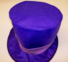 WILLY WONKA CHARLIE CHOCOLATE FACTORY HAT PURPLE FELT SOFT HAT FULLY BENDABLE SHIPS FOLDED LIGHTWEIGHT NICE FOR HALLOWEEN PLAYS UNEXPENSIVE KID FRIENDLY, WE SHIP FAST by HAT PRODUCTS INTNTL. $7.95. PURPLE TOP SOFT HAT WONKA CHOCOLATE FACTORY HAT LIGHTWEIGHT FITS MOST IT WILL SHIP FOLDED PERFECT FOR PLAYS, SCHOOL, HALLOWEEN, PARTIES AND MORE