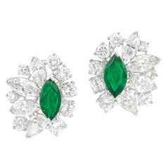 Pair of Platinum, Emerald and Diamond Earclips, Oscar Heyman Bros. Centering 2 marquise-shaped emeralds approximately 1.25 cts., surrounded by 6 marquise-shaped, 2 pear-shaped and 16 round diamonds approximately 5.80 cts., with maker's mark, no. 76449, approximately 6 dwts.