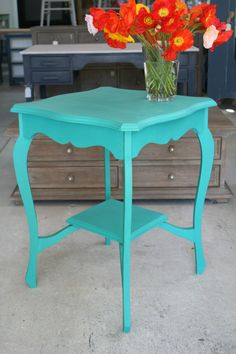 Cute vintage side table painted in a Moroccan blue.  Dimensions: 60cm wide, 60cm deep, 76cm tall