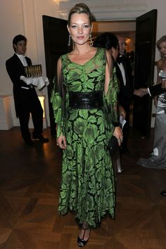 Kate Moss in a vintage leaf print silk dress. I would say this is from the 1930's and she is wearing a black leather corset belt its stylish.