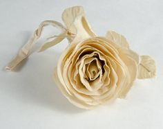 Beautiful Ivory silk rose. It measures about 5 1/2 long and 3 wide. I havent tested the fabric but it feels like silk. A couple of the outer petal are