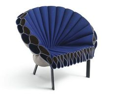The Peacock Chair - Dror: This inviting chair is made of three sheets of felt which are tightly woven and a metal frame. There is no sewing