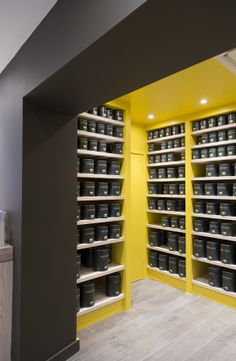 Our beautiful Little Greene paint tins. Little Greene Paint Company, Retail Store Design, Paint Shop, Shoe Rack, Showroom, Storage, Wood, Interior, Painting