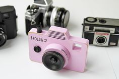 Today I made a little wood pretend toy camera.  Pink.  With a real leather strap. For my little tourist:   It's modeled off my Holga camera....with a viewfinder:   I've always want...
