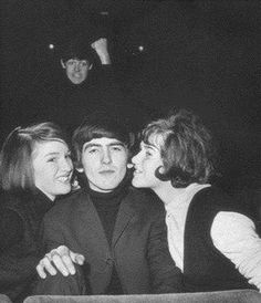 ...one of the best photobombs of all time, Beatles legend Paul McCartney creeps up behind George Harrison